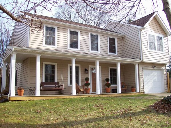 House with new beige vinyl siding, replaced by Bohan Contracting
