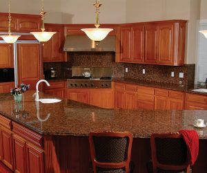 Renovated Kitchen With Custom Cherry Cabinets Massive Center Island Stacked Stainless Steel Appliaces