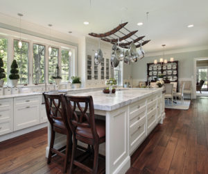 Large Center Island With End Cap Seating Stainless Steel Appliances White Cabinets